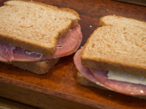 Ingredients and making of a croque monsieur French ham and cheese sandwich, toasted, meal, gruyere,