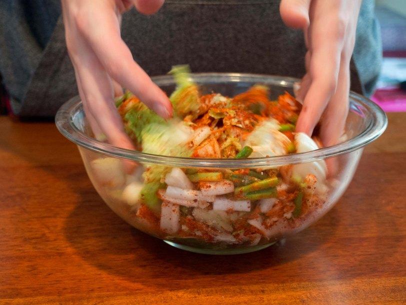 Hands Mixing Homemade Kimchi